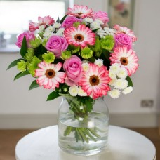 Bouquet including gorgeous pink roses, pink edged gerberas and dainty white daisies